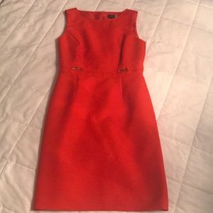 Orange Tahari sheath dress with gold waist details